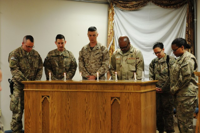 3d ESC Soldiers participate in a Holocaust Remembrance Ceremony  April 28 at the New Kabul Compound chapel.