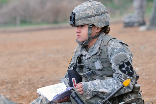 "WARRIOR BASE, South Korea - A Soldier contemplates her next move during the 2014 ""EFMB on the DMZ"" event held 21 April-2 May. Soldiers from the 2nd Infantry Division dominated the 2014 Eighth U.S. Army Expert Field Medical Badge qualification.  Of the 242 medical competitors from around the Korean peninsula who participated in the two-week event, only 18 Soldiers remained. Of the 18 left standing, 12 2nd Inf. Div. Soldiers were pinned with the coveted EFMB to wear proudly above their U.S. Army nameplate on their uniforms."