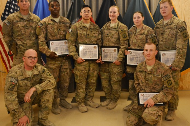 Eight Soldiers from the 23rd Military Police Co., 91st Military Police Battalion, 10th Sustainment Brigade, who completed more than 2300 ammo abatement inspections at Logistics Task Force Bagram Redistribution Property Assistance Team received certificates of appreciation and commander's coins from Lt. Col. Marvin L. Walker, 3-401st Army Field Support Battalion commander May 1. Front row: Spc. Jeremy Drewry and Sgt. Cory Burnley. Back row: Spc. Nicholas Tholcke, Spc. Alonte Echols, Spc. Anthony Tran, Spc. Sarah Doolittle, Pfc. Alicia Sheehan and Spc. Brian Wateski.