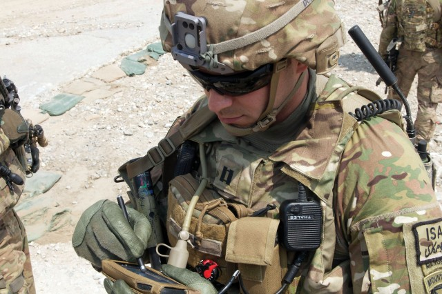 Cpt. Jonathan Page of the 4th Brigade Combat Team (BCT), 10th Mountain Division uses the Nett Warrior device at Nangalam Base, Afghanistan. The alignment of the CP CE, MCE and mobile, handheld environment will help meet the expectations of today's tech-savvy Soldier.