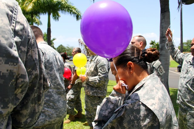A Tripler Army Medical Center Staff member pauses to remember lives lost during the holocaust before a ballon release during the Holocaust National Days of Remembrance ceremony on May 1, 2014.
