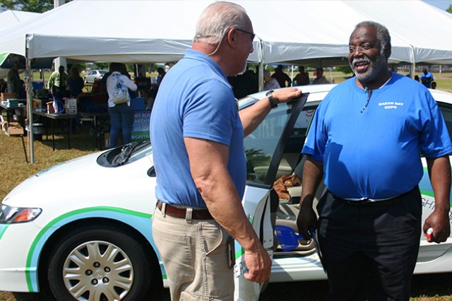 The Southeast Alabama Gas District attended the Earth Day Expo, showing off a natural gas-powered Honda Civic. Terry Tradaway, marketing representative for SEAGD's Central Division, takes time to discuss the importance of natural gas-powered vehicles with Johnny Buchanan, Fort Rucker Environmental Office.