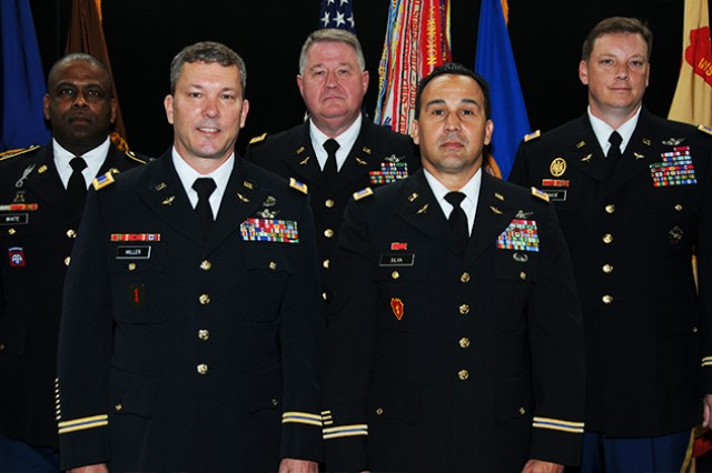 First Sgt. Brian R. White, CW5 Charles A. Miller Jr., Maj. Terry Brooks, CW5 Johnny Silva and CW4 Steven A. Haase retired during a ceremony April 25 at the U.S. Army Aviation Museum.