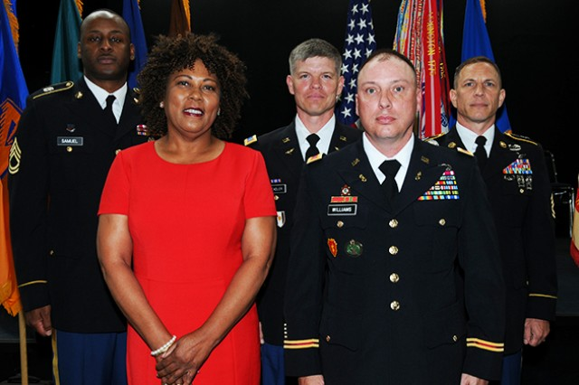 Sgt, 1st Class Joseph H. Samuel, Muriel L. Scott, CW4 Eric J. Stadler, CW4 Brian C. Williams and Sgt. 1st Class Bret L. Clemens retired during a ceremony April 25 at the U.S. Army Aviation Museum.