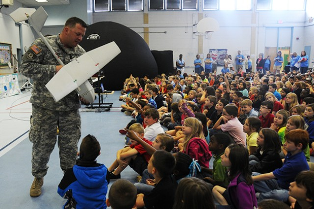 CW3 Carl Miller, B. Company, 1st Battalion, 13th Aviation Battalion, shows off the RQ-11B Raven to students at FRES as part of STEM Fest April 25.