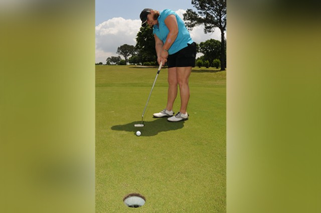 Tournament player Kris Laster putts April 25 during a golf tournament benefiting AER.