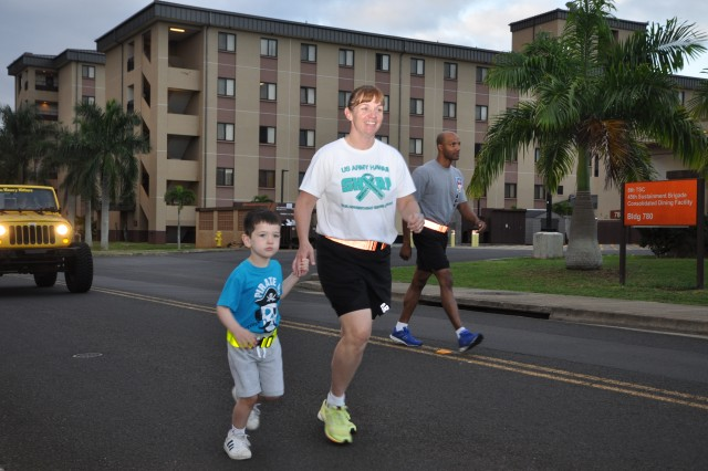 Soldiers and families of the 311th Signal Command (Theater) and 516th Signal Brigade gathered on Schofield Barracks for a run/walk Apr 11. The event was to raise awareness for sexual assault prevention as April is Sexual Assault Awareness Month.