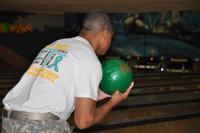 A Soldier from 516th Signal Brigade prepares for his turn to bowl during a bowling tournament hosted by the Brigade Apr 17. The event was to raise awareness for sexual assault prevention as April is Sexual Assault Awareness Month.