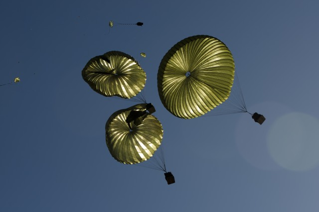 A load of supplies rigger in the container delivery systems is seen high above Adazi Drop Zone, Latvia, as paratroopers from the 173rd Airborne Brigade, conduct and receive an aerial resupply mission, May 2, 2014.
