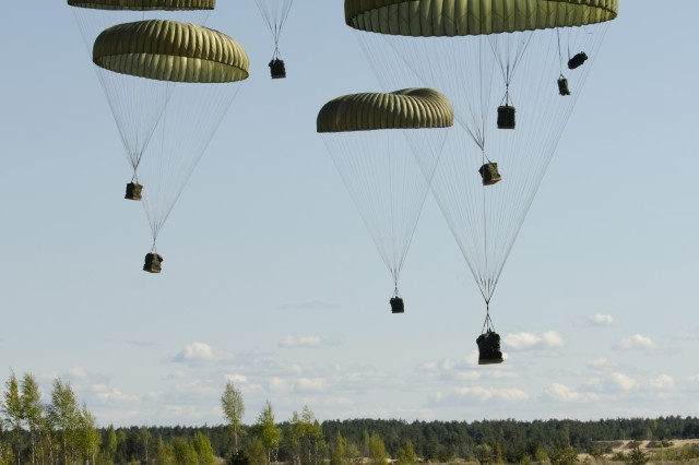 Parachute-delivered supplies are seen landing on Adazi Drop Zone, Latvia, as part of a 173rd Airborne Brigade aerial resupply mission, May 2, 2014.