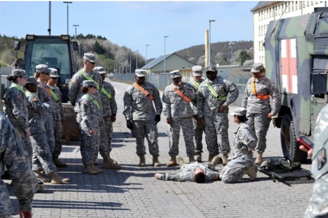 Soldiers from various units within the 16th Sustainment Brigade, 21st Theater Sustainment Command, participate in an emergency first responder training lane during railhead training at Quartermaster Kaserne in Baumholder, Germany, April 10, 2014.