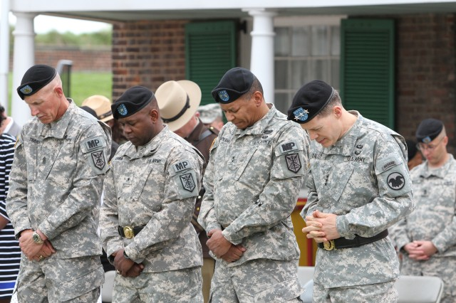 Command Sgt. Maj. Kurtis J. Timmer (left), incoming commander Brig. Gen. Phillip M. Churn Sr., outgoing commander Maj. Gen. Sanford E. Holman and Chief of the Army Reserve and commanding general, United States Army Reserve Lt. Gen. Jeffrey W. Talley (right) stand during the invocation of the 200th Military Police Command's relinquishment of command ceremony, Fort McHenry, Md., May 4, 2014. There are 14,000 Soldiers within the reserve command covering 44 states across the U.S.