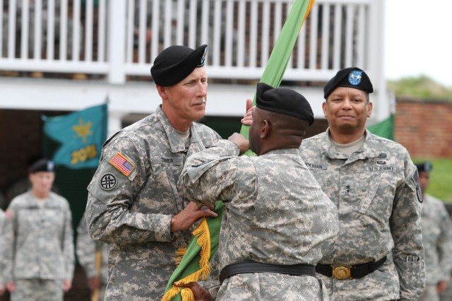 Command Sgt. Maj. Kurtis Timmer (left), passes the unit guidon to incoming commander Brig. Gen. Phillip Churn Sr., as outgoing commander Maj. Gen. Sanford Holman looks on during a 200th Military Police Command's relinquishment of command ceremony, Fort McHenry, Md., May 4, 2014. (U.S. Army Reserve photo by Sgt. Marc Loi, 200th Military Police Command Public Affairs, Fort Meade, Md.)