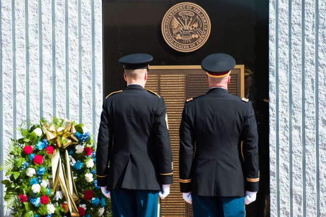 from left, Sgt. Maj. Brian Curtis and Maj. David Duncan stand by to lay a wreath to honor their Fallen Comrades at the Explosive Ordnance Disposal (EOD) 45th Annual memorial Service at the Kauffman EOD Training Complex on Eglin Air Force Base, FL, May 3, 2014.  The Service is held every year to honor EOD Technicians who had sacrificed their lives in the performance of duty.  (U.S. Army photo by Staff Sgt. Steve Cortez/ Released)
