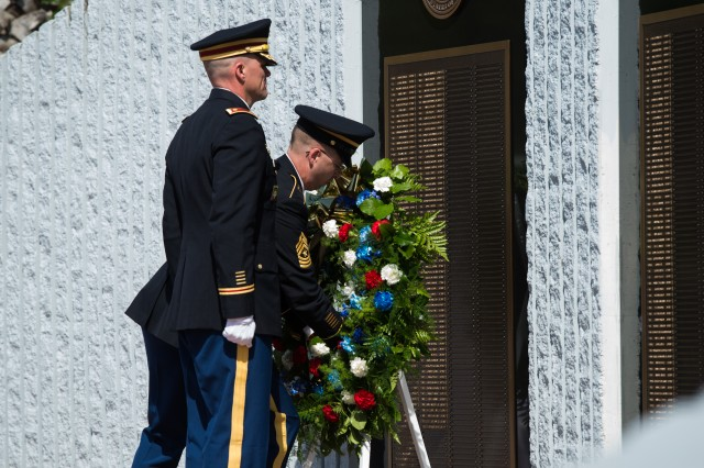 from left, Sgt. Maj. Brian Curtis and Maj. David Duncan lay a Wreath to commemorate Fallen Comrades during the Explosive Ordnance Disposal (EOD) 45th Annual memorial Service at the Kauffman EOD Training Complex on Eglin Air Force Base, FL, May 3, 2014.  The Service is held every year to honor EOD Technicians who had sacrificed their lives in the performance of duty.  (U.S. Army photo by Staff Sgt. Steve Cortez/ Released)