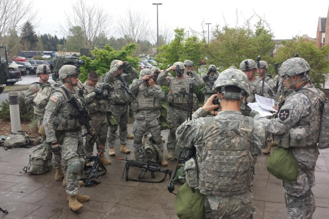 First Lt. Jacob Persoon, the platoon leader of 1st Platoon, Company C, 1st Battalion, 17th Infantry Regiment, 2-2 Stryker Brigade Combat Team, 7th Infantry Regiment, and Sgt. 1st class Desmond Politini, platoon sergeant of 1st Platoon, C Company, 1-17 Infantry, hold a safety brief prior to urban-operations training.
