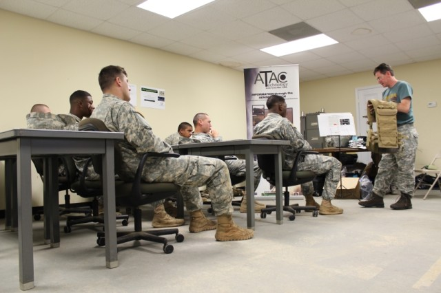 Bruce Mortimer, director of Research and Development, Engineering Acoustics, Inc., Casselberry, Fla., provides training to the Soldiers prior to field assessments. Soldiers quickly learned how to use a tactile navigation system, and attained proficiency with the signals within 10-15 minutes.