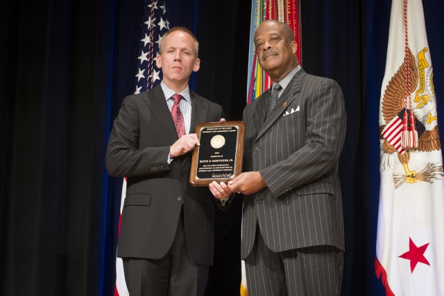 Under Secretary of the Army Brad R. Carson presents Rufus B. Caruthers with the Diversity and Leadership Programs Award (Equal Employment Opportunity Professional), during the 2014 Secretary of the Army Awards, at the Pentagon, May 5, 2014.