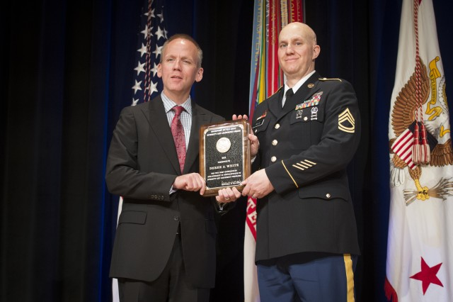 Under Secretary of the Army Brad R. Carson presents Sgt. 1st Class Derek A. White with the Diversity and Leadership Award  (Equal Opportunity Advisor), during the 2014 Secretary of the Army Awards ceremony, at the Pentagon, May 5, 2014.