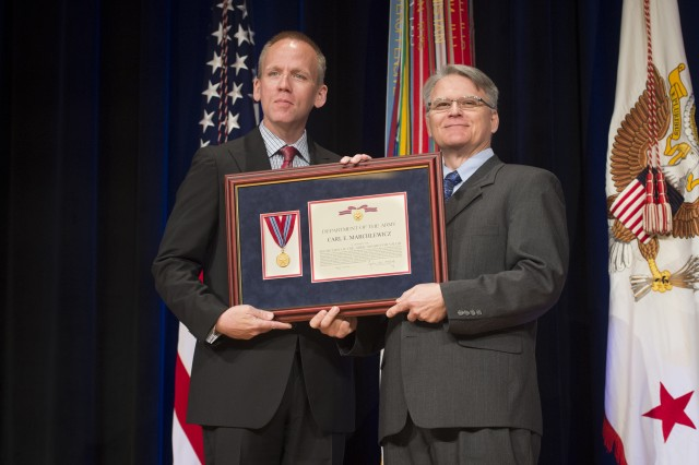 Under Secretary of the Army Brad R. Carson presents Carl E. Marchlewicz with the Secretary of the Army Award for Valor, during the 2014 Secretary of the Army Awards ceremony, at the Pentagon, May 5, 2014.