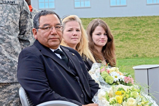 Daniel Alonzo Sr., Claudia Pena and Lisa Maria Pena sit in the memorial garden dedicated to survivors of fallen Soldiers during the Gold Star Spouse and Survivor Recognition Ceremony April 22 on Wiesbaden's Clay Kaserne.