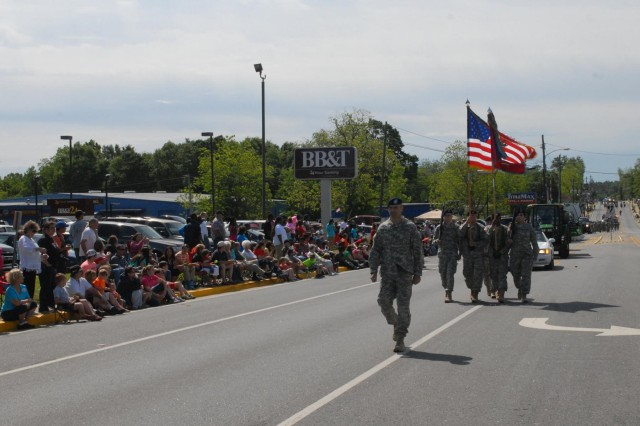 Lt. Col. Brandon Klink, commander of the 703rd Brigade Support Battalion, 4th Infantry Brigade Combat Team, 3rd ID, and the color guard lead the 69th Annual Pine Tree Festival parade in Swainsboro, Ga., May 3, 2014. This was the fifth consecutive year the 3rd Infantry Division supported the festival that celebrates the community's wood industry. (U.S. Army Photo by Staff Sgt. Elvis Umanzor, 4th IBCT, 3rd ID, Public Affairs)