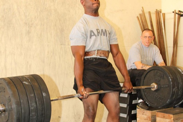 Sgt. Kenny Grisham, 10th Regional Support Group, deadlifts 455 pounds during the first Headquarters and Headquarters Company, 10th Regional Support Group Power Lifting Competition on Torii Station, Okinawa, Japan, April 30. This competition was held to promote higher levels of fitness and build morale amongst the Soldiers that competed.