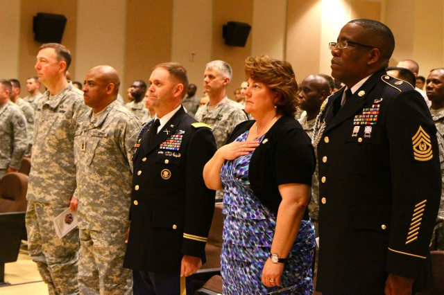 CAMP CARROLL, South Korea - The command teams from the 19th Expeditionary Sustainment Command and the United States Army Garrison-Daegu look on while the National Anthem plays. The Area IV Quarterly Retirement Ceremony honoring three Soldiers for their 69 years of combined service was held at the Camp Carroll theater, April 25.