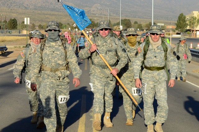 The 707th Military Intelligence Battalion military heavy competition team sets a quick pace in the first part of the 26.2 mile 25th Annual Bataan Memorial Death March at White Sands Missile Range, New Mexico, March 23. The team members (from left to right) are Spc. Peter J. Waldorf, Spc. Johnathan N. Evans, Staff Sgt. Cody J. Shields, Sgt. Thomas S. Vilaythong and Capt. Jamen K. Miller.