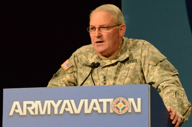 Lt. Gen. James Barclay, deputy chief of staff, G-8, speaks to aviators at the two-day Army Aviation Association of America 2014 Mission Solutions Summit at the Gaylord Opryland Hotel in Nashville, May 6, 2014.