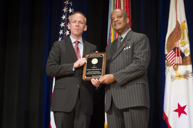 Photo Credit: Staff Sgt. Bernardo Fuller Under Secretary of the Army Brad R. Carson presents Rufus B. Caruthers with the Diversity and Leadership Programs Award (Equal Employment Opportunity Professional), during the 2014 Secretary of the Army Awards, at the Pentagon, May 5, 2014.