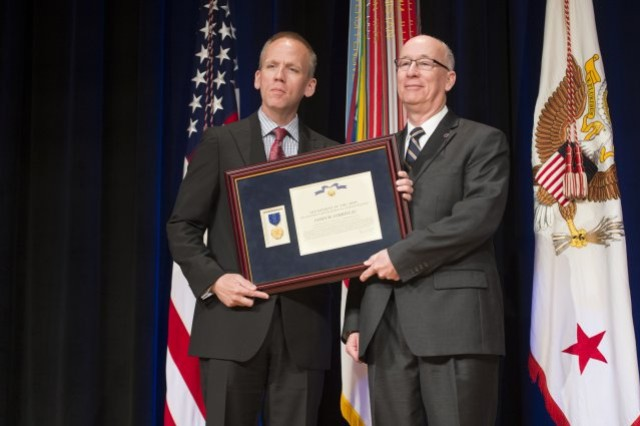 Photo Credit: Staff Sgt. Bernardo Fuller Under Secretary of the Army Brad R. Carson presents James W. Corriveau with the Decoration for Exceptional Civilian Service, during the 2014 Secretary of the Army Awards ceremony, at the Pentagon, May 5, 2014.