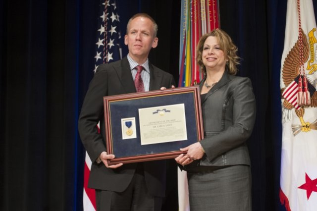 Photo Credit: Staff Sgt. Bernardo Fuller Under Secretary of the Army Brad R. Carson presents Lori A. Loan with the Decoration for Exceptional Civilian Service, at the 2014 Secretary of the Army Awards ceremony, at the Pentagon, May 5, 2014.