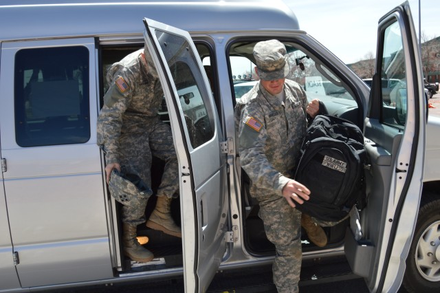 FORT CARSON, Colo. -- Pvt. Zach Hartman, left, and Pvt. Chris Wheless, both from 3rd Assault Helicopter Battalion, 4th Combat Aviation Brigade, 4th Infantry Division, climb out of a post shuttle, April 24, 2013. The shuttle is free and open to all Soldiers and, on a space available basis, their Families and Department of Defense civilians.