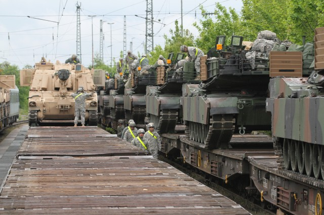Soldiers from 1st Brigade Combat Team, 1st Cavalry Division off-load their vehicles from the rail cars at the Parsberg Railhead. The Soldiers are participating in Combined Resolve II, a U.S. Army Europe-directed multinational exercise at the Grafenwoehr and Hohenfels Training Areas, including more than 4,000 participants from 13 allied and partner countries (U.S. Army photos by Capt. John Farmer, 1st BCT, 1st Cav Public Affairs).