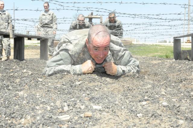 Sgt. 1st Class John Taffe, Company D, 3rd Battalion, 10th Infantry Regiment negotiates an obstacle.