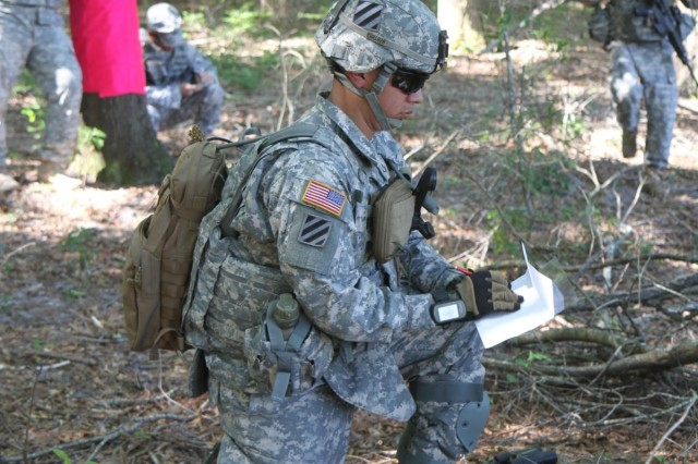 Pfc. Daniel Rodriguez, a native of Salinas, Calif., and a forward observer with 1st Battalion, 76th Field Artillery Regiment, 4th Infantry Brigade Combat Team, 3rd Infantry Division, attached to 3rd Battalion, 15th Infantry Regiment, 4th IBCT, draws a terrain sketch of his intended target area, used to aid in the description of his hidden position to friendly forces, during 1-76 FA's fires support team certification exercise on Fort Stewart, Ga., May 6, 2014. (U.S. Army Photo by Sgt. Bob Yarbrough, 4th IBCT, 3rd ID, Public Affairs)
