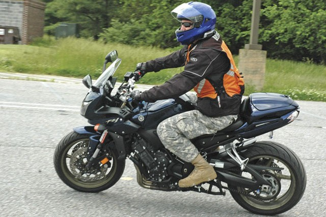 Sgt. 1st Class Christopher Cox of 20th CBRNE Command circles the motorcycle course during a bike show hosted by the APG Installation Safety Office in May 2013.