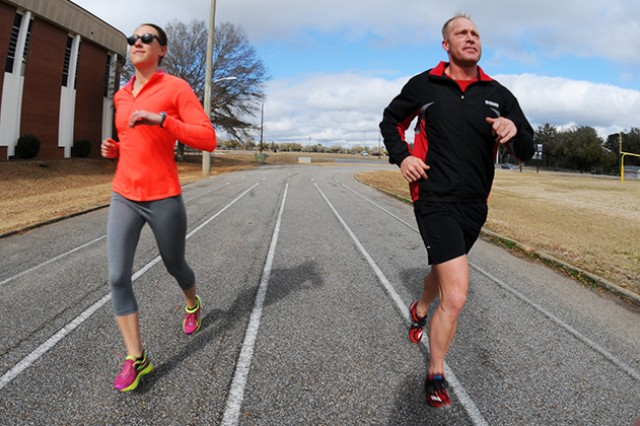 W01 Adam Sniffen, B Company, 1st Battalion, 145th Aviation Regiment and participant in the Run/Walk Mileage Club, runs with his friend, 1st Lt. Cierra O'Connor, D Co., 1st Bn., 145th Avn. Regt., at the Fort Rucker Physical Fitness Center track recently.