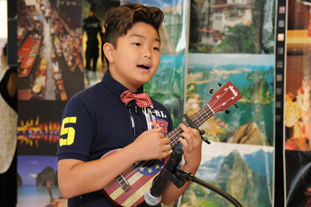 "Han Lee, of Enterprise Elementary School, performs the song, ""I'm Yours,"" by Jason Mraz as he plays the ukulele during the Asian-Pacific American Heritage Month kickoff event at the post exchange May 2."