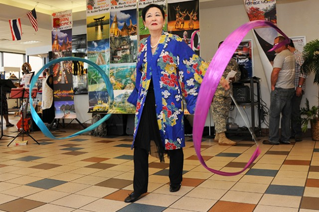 Carol Hara, the area's first Asian Senior Ms. Wiregrass, performs a traditional Japanese ribbon dance during the Asian-Pacific American Heritage Month kickoff event at the post exchange May 2.