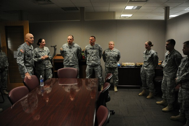 Command Sgt. Maj. Scott Schroder (left), III Corps and Fort Hood command sergeant major, talks to career counselors about the new AC2RC program at the Reserve Component retention office inside the Copeland Center.
