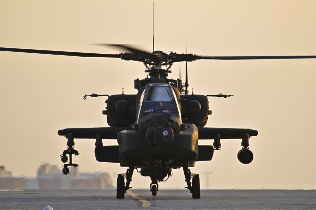 An AH-64 Apache departs Bagram Airfield, Afghanistan. Apaches often team with unmanned aircraft in Afghanistan.
