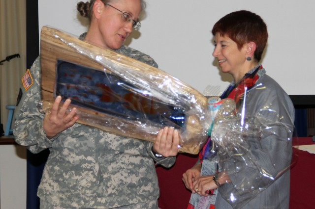 Col. Jennifer Bedick, Regional Nurse Executive for Pacific Regional Medical Command (PRMC) and Deputy Commander for Nursing at Tripler Army Medical Center (TAMC), presents Col. (ret.) Stephanie Marshall, Director for Community Partnerships for the School of Nursing and Dental Hygiene at the University of Hawai'i and former Commander of TAMC in 2004 a token of appreciation for her encouraging and appreciative speech given during an awards ceremony at TAMC in honor of National Nurses Week, May 6th through May 12th. National Nurses Week honors nurses as leaders who improve the quality of health care and practice in diverse roles such as clinicians, administrators, researchers, educators and policymakers.