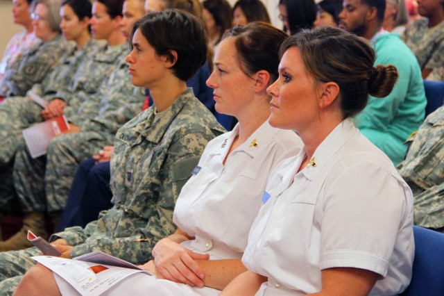 Two nurses wear the white duty uniform for a National Nurses Week awards ceremony honoring excellence in nursing at Tripler Army Medical Center. Nurses around the country will celebrate National Nurses Week with the culmination on May 12th, the birthdate of Florence Nightingale, founder of modern nursing.