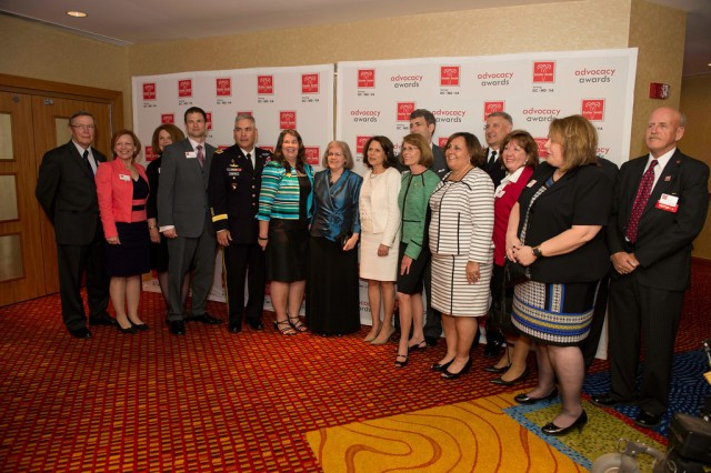 "Vice Chief of Staff of the Army Gen. John F. Campbell, his wife Ann, and Hollister K. ""Holly"" Petraeus, were honored May 6, 2014, as recipients of the 2014 Advocacy Award by the chapter of the Easter Seals organization which serves the national capital region."