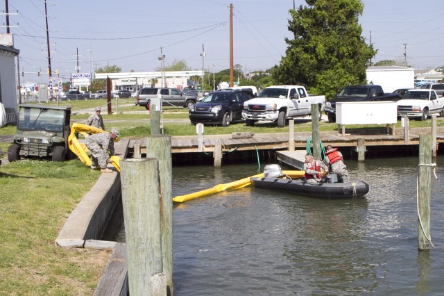 Soldiers of the 824th Transportation Company (Heavy Watercraft) quickly responded to an explosion of a 28-foot fishing boat that occurred at the civilian side of the North Carolina State Port in Morehead City on April 3. They assisted in first aid and damage control until civilian authorities arrived. Here a spillage response boom is readied to prevent further contamination of the water by fuel and other possible hazardous material.