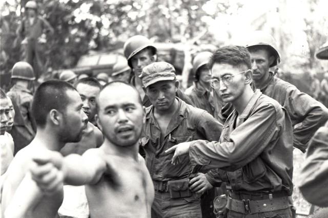 T-3 Harry Fukuhara, interrogating a Japanese prisoner-of-war on Aitape, New Guinea, in April 1944
