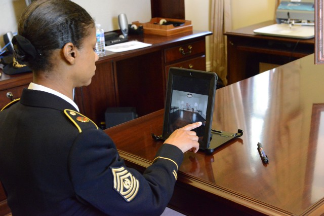 Command Sgt. Maj. Earlene. Y. Lavender, Joint Base Myer-Henderson Hall command sergeant major looks at the photos of the courtroom on an IPAD set up inside Grant Hall for use by visitors with mobility restrictions at the inaugural public open house of Grant Hall's third-floor courtroom at the Fort Lesley J. McNair portion of JBM-HH, May 3, 2014.