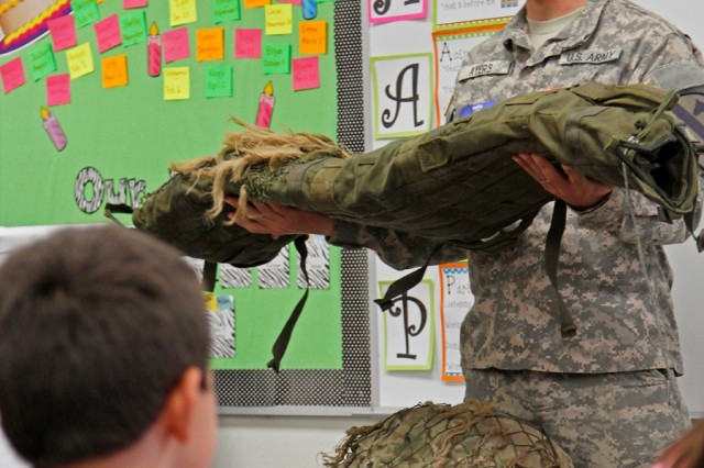 "Spc. Charles Ayers, a Tonasket, Washington native and infantryman assigned to Headquarters and Headquarters Company of the 2nd  Battalion""Lancer,"" 5th Cavalry Regiment, 1st Brigade Combat Team ""Ironhorse,"" 1st Cavalry Division, explains the duties of a sniper to Joe M. Pirtle Elementary School students during career day at the Lancer's adopted school May 2 in Belton, Texas. Two combat medics, a mechanic, a sniper, a tanker and a cavalry scout made the 25-minute journey to showcase their skills in support of their adopted school. (U.S. Army photo by Spc. Paige Behringer, 1BCT PAO, 1st Cav. Div.)"